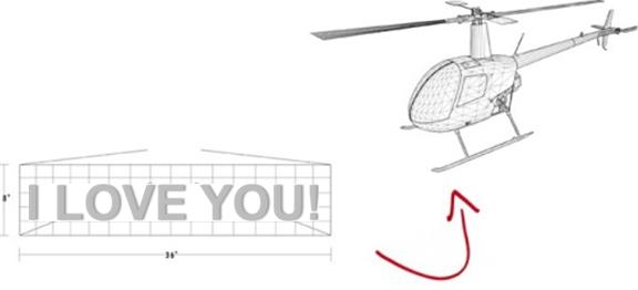 Helicopter with Valentines Day messages flying in the sky
